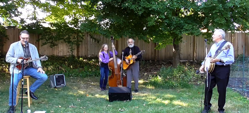 Southern Rail, featuring John Tibert, left, Sharon Horovitch, Jim Muller and Rich Stillman, perform an outdoor concert for fans. The recorded event will be featured by the Rose Garden Coffeehouse at 7 p.m. Dec. 5, 2020.